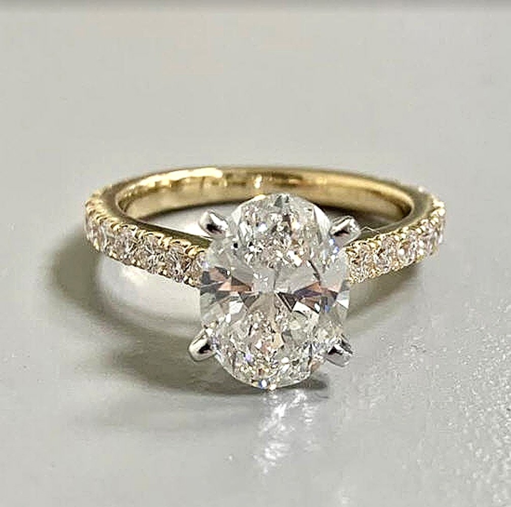 """RING 18KY.G. w/2.40CT G/VS2 OVAL """"GIA"""" PLUS 0.75CT ROUNDS """"SPECIAL ORDER"""""""